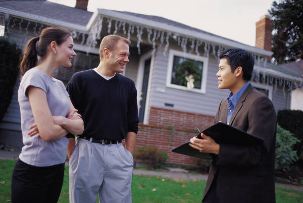 Photo of people meeting with a real estate broker